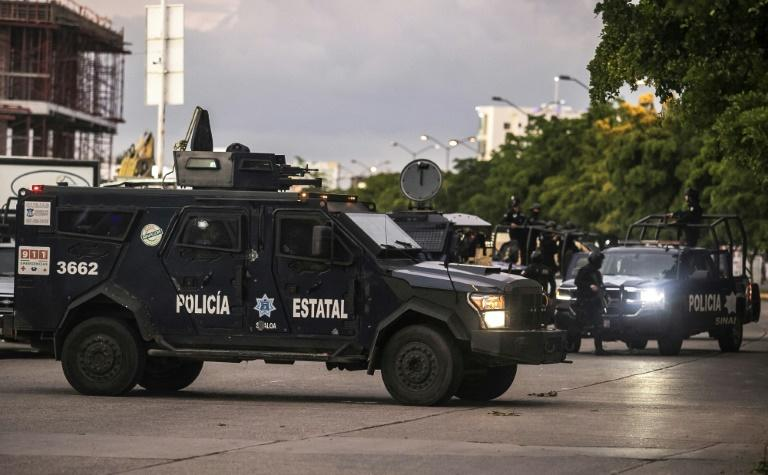 Mexican police patrol in Culiacan after heavily armed gunmen fought an intense battle with security forces