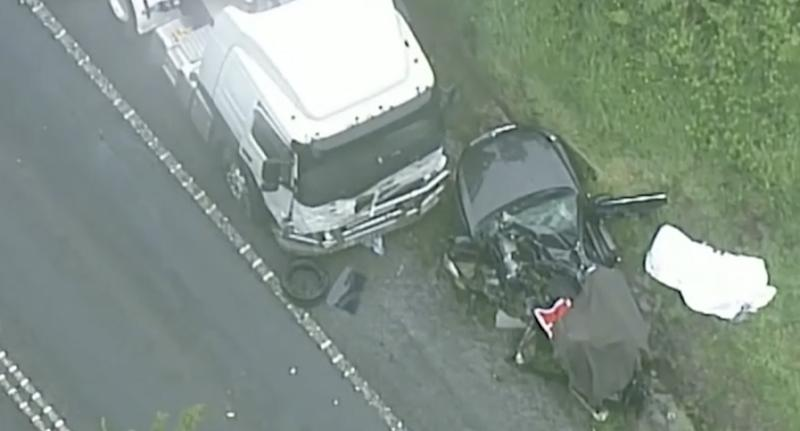 A smashed car next to a truck on South Gippsland Highway, Korumburra.