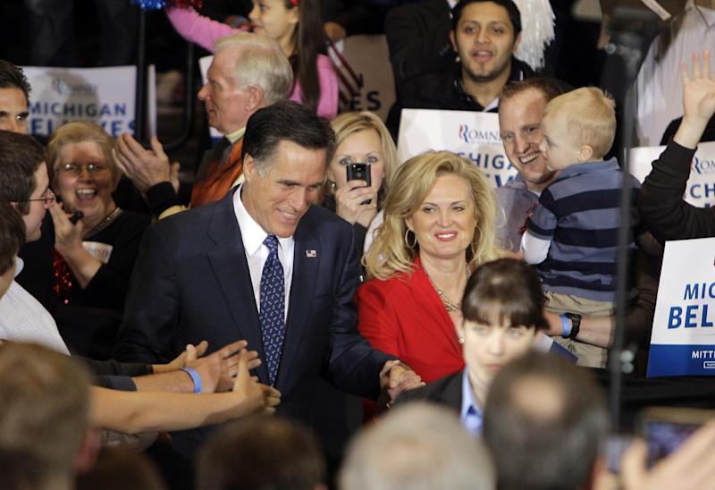 Republican presidential candidate, former Massachusetts Gov. Mitt Romney and his wife Ann arrive at his election night party in Novi, Mich., Tuesday, Feb. 28, 2012. (AP Photo/Carlos Osorio)