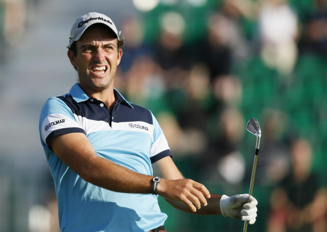 Edoardo Molinari of Italy watches his shot off the 4th tee during the first day of the British Open Golf championship at the Royal Liverpool golf club, Hoylake, England, Thursday July 17, 2014. (AP Photo/Alastair Grant)