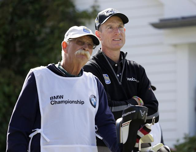 """Jim Furyk, right and his caddie Mike """"Fluff"""" Cowan look out from the third tee during the second round of the BMW Championship golf tournament at Conway Farms Golf Club in Lake Forest, Ill., Friday, Sept. 13, 2013. Furyk posted a single round 59, tying the PGA Tour record. (AP Photo/Charles Rex Arbogast)"""