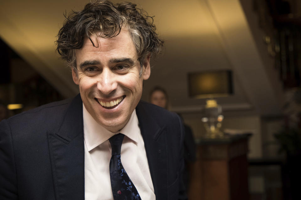 Actor Stephen Mangan poses for photographers upon arrival at the Women in Film and TV Awards, in London, Friday, Dec. 7, 2018. (Photo by Vianney Le Caer/Invision/AP)