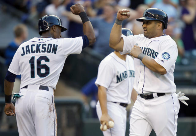 Seattle Mariners' Kendrys Morales, right, is congratulated by teammate Austin Jackson after Morales hit a two-run home run that scored Jackson during the first inning of a baseball game against the Toronto Blue Jays, Wednesday, Aug. 13, 2014, in Seattle. (AP Photo/Stephen Brashear)