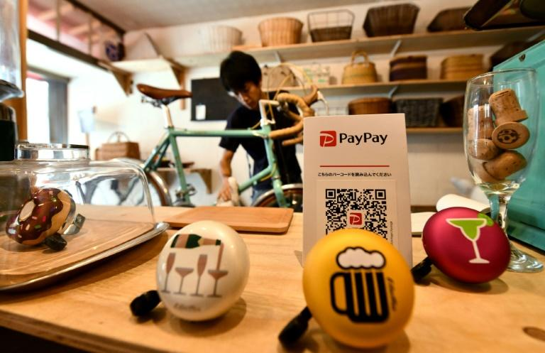 Only 'two or three' people a week use the PayPay system at Katsuyuki Hasegawa's bike repair shop
