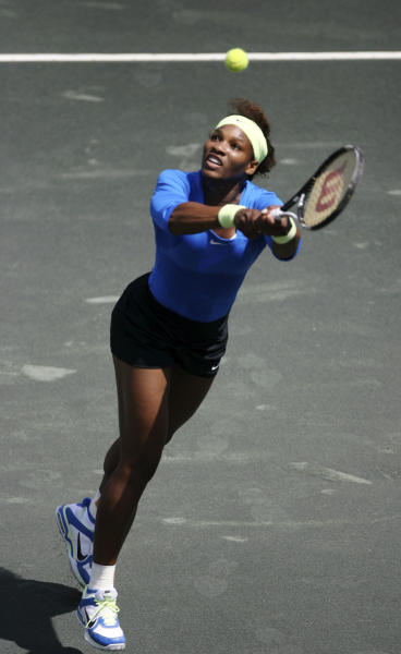 Serena Williams returns a shot against Marina Erakovic, of New Zealand, during their match at the Family Circle Cup tennis tournament in Charleston, S.C., Thursday, April 5, 2012. (AP Photo/Mic Smith)