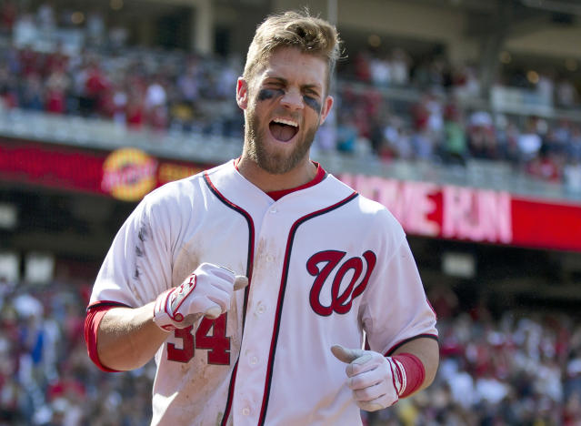 Washington Nationals' Bryce Harper celebrates his game winning two-run home run in the ninth inning of a baseball game against the Pittsburgh Pirates at Nationals Park on Thursday, July 25, 2013, in Washington. The Nationals won 9-7. (AP Photo/Evan Vucci)