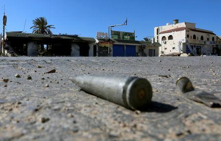 FILE PHOTO: Shell casings are seen on the ground  during a fight between members of the Libyan internationally recognised government forces and Eastern forces in al-Yarmouk south of Tripoli, Libya May 7, 2019. REUTERS/Hani Amara/File Photo