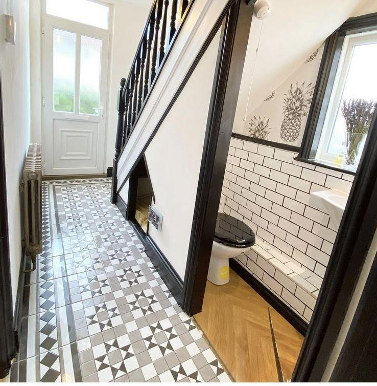 <p>'I thought we needed a downstairs toilet, so we added a tiny basin and toilet under the stairs. As well as this, we installed new mosaic tiles and did an awful lot of painting and stripping on the stairs. To finish, we added a little doghouse, which our dog absolutely loves!'</p>