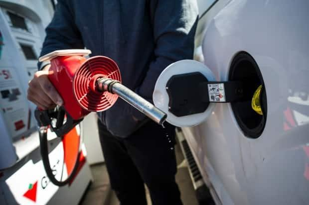 One expert says higher costs at the pump are tied to an increase in crude oil prices.  (Christopher Katsarov/The Canadian Press - image credit)