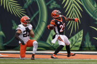 Cincinnati Bengals' Giovani Bernard (25) celebrates a touchdown against Cleveland Browns' Andrew Sendejo (23) during the second half of an NFL football game, Sunday, Oct. 25, 2020, in Cincinnati. (AP Photo/Bryan Woolston)