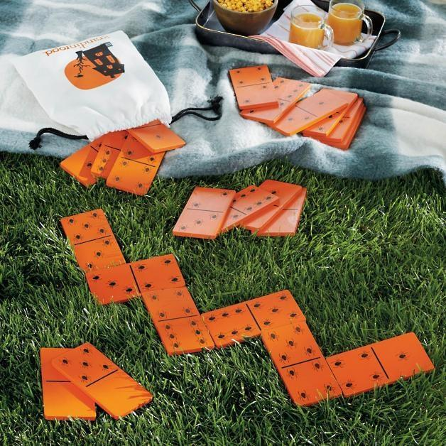 <p>Take this classic table game to your outdoor patio with the <span>Backyard Halloween Dominos</span> ($70).</p>