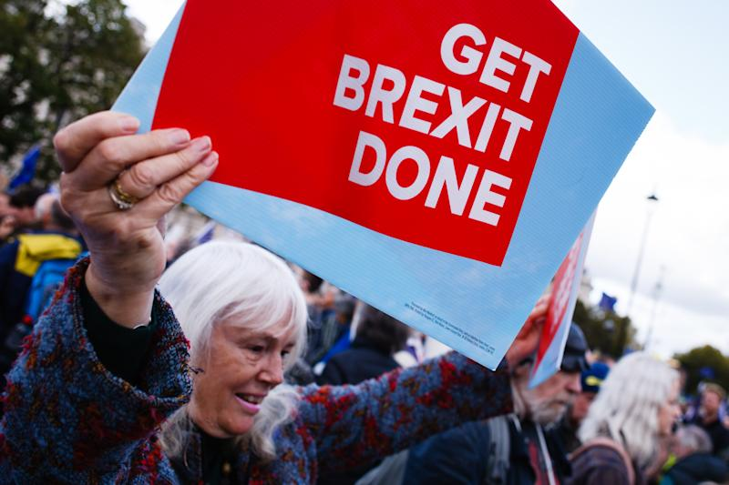 A pro-Brexit activist with a placard at Parliament Square as anti-Brexit activists protest. A mass 'Together for the Final Say' march, organised by the 'People's Vote' campaign for a second Brexit referendum. Britain's political crisis over Brexit has once again reached fever pitch as the UK's October 31 departure date from the EU draws closer, with MPs and the public as divided as ever over the issue. Campaigners for the so-called People's Vote, or 'Final Say' referendum, argue that the kind of Brexit on offer from Boris Johnson's government has diverged so far from promises made by him and other 'Leave' advocates in 2016 that the public must again be consulted on whether it wants to proceed. (Photo by David Cliff / SOPA Images/Sipa USA)