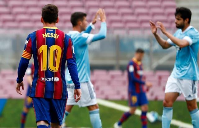 Messi walks past as Celta players celebrate