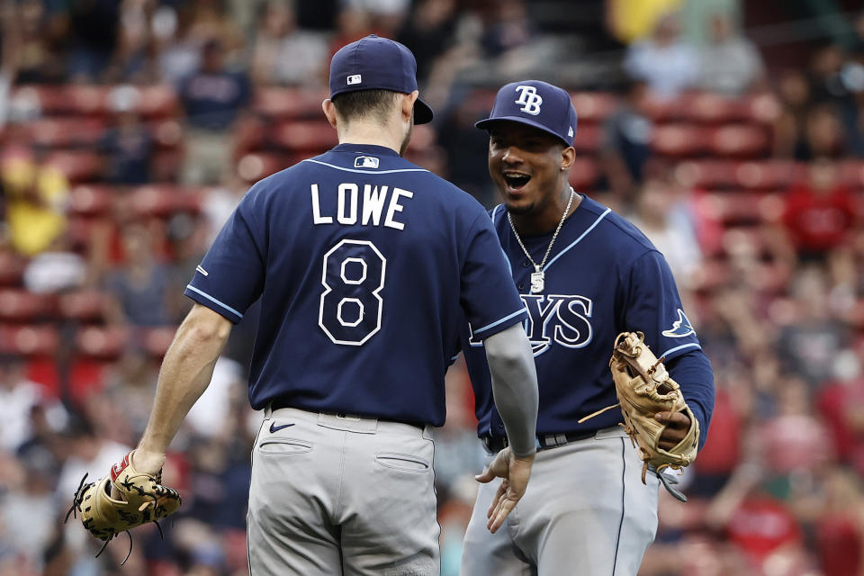 Tampa Bay Rays' Wander Franco celebrates with Brandon Lowe (8) after they defeated the Boston Red Sox in 10 innings of a baseball game Monday, Sept. 6, 2021, at Fenway Park in Boston. (AP Photo/Winslow Townson)