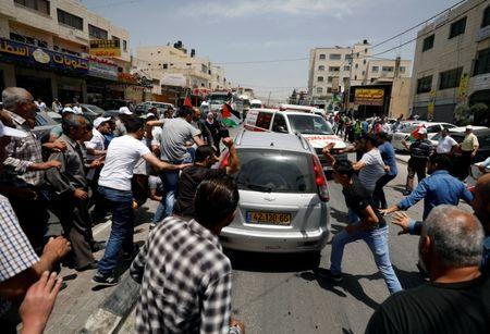 Protester killed, AP journalist wounded in West Bank clash