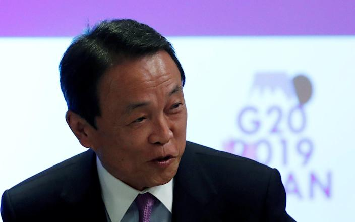 Taro Aso has sparked controversy with his comments - ISSEI KATO/REUTERS