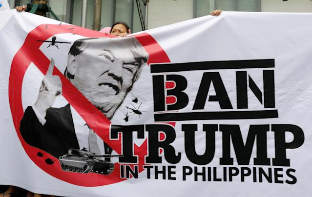 <p>Protesters display a banner during a rally against U.S. President Donald Trump's visit, outside the Trump Tower in Makati, Metro Manila, Philippines, Nov. 9, 2017. (Photo: Erik De Castro/Reuters) </p>
