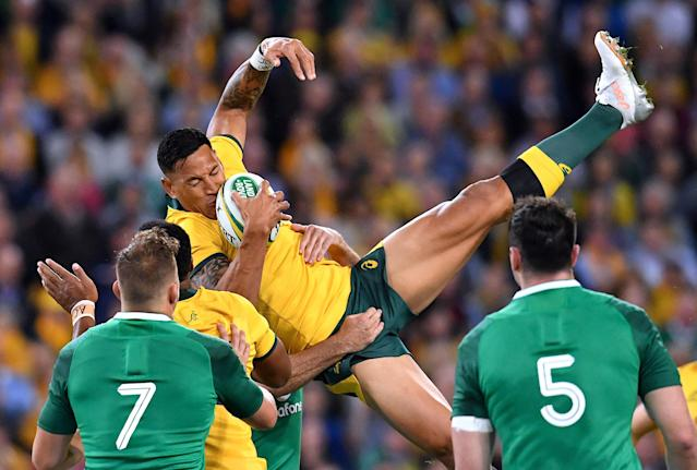 Rugby Union - June Internationals - Australia vs Ireland - Lang Park, Brisbane, Australia - June 9, 2018 - Israel Folau of Australia falls after catching the ball. AAP/Darren England/via REUTERS ATTENTION EDITORS - THIS IMAGE WAS PROVIDED BY A THIRD PARTY. NO RESALES. NO ARCHIVE. AUSTRALIA OUT. NEW ZEALAND OUT. TPX IMAGES OF THE DAY
