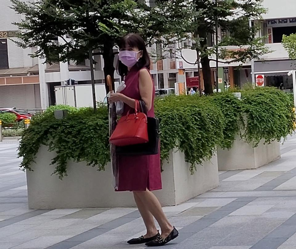 Tan Beow Hiong exited the State Courts after her court hearing on 2 July. (PHOTO: Yahoo News Singapore/Wan Ting Koh)