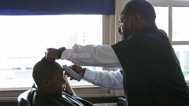 PHOTO: Principal Dr. Terrance Newton cutting a student's hair at the barbershop he opened at Warner Elementary School. (Courtesy Robert Markopoulos/Moises Velazquez)