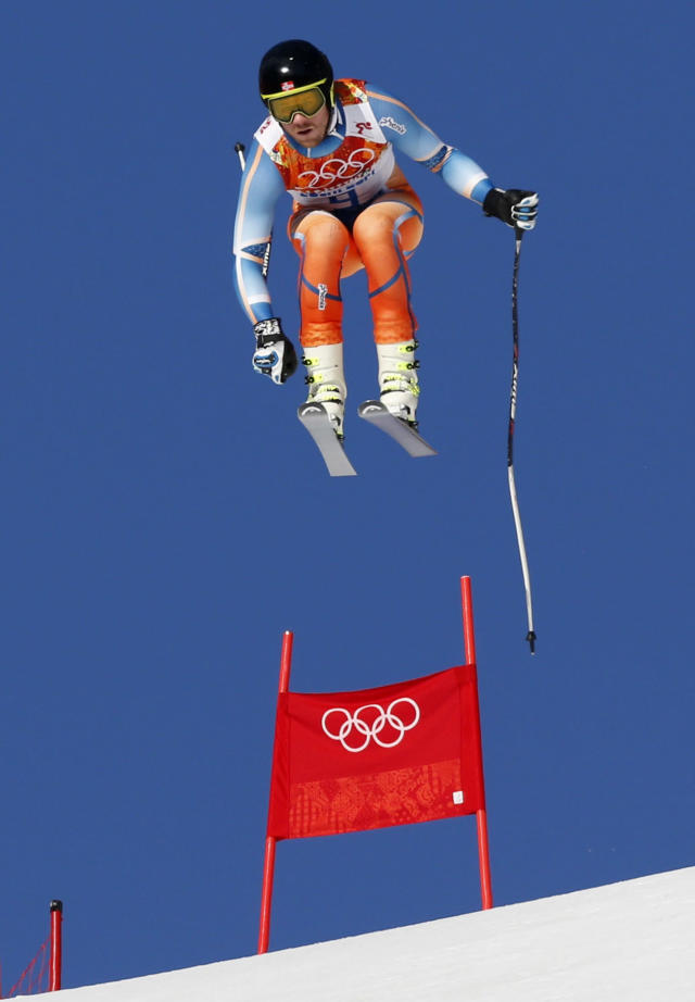 Norway's Kjetil Jansrud goes airborne during the downhill run of the men's alpine skiing super combined event at the 2014 Sochi Winter Olympics at the Rosa Khutor Alpine Center February 14, 2014. REUTERS/Stefano Rellandini (RUSSIA - Tags: SPORT SKIING OLYMPICS)