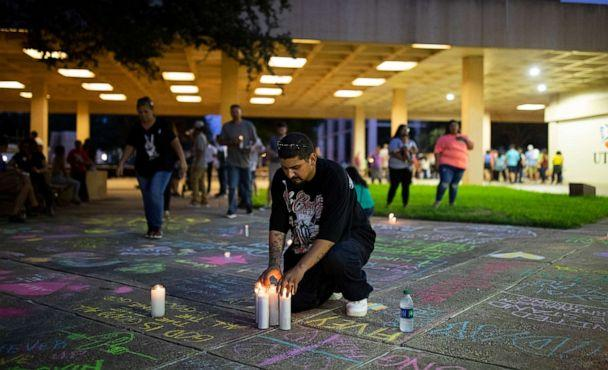 PHOTO: George Guerrero leaves candles at a makeshift memorial after a vigil at the University of Texas Permian Basin for the victims of the mass shooting in Odessa, Texas, Sept. 1, 2019. (Ivan Pierre Aguirre/The New York Times via Redux)