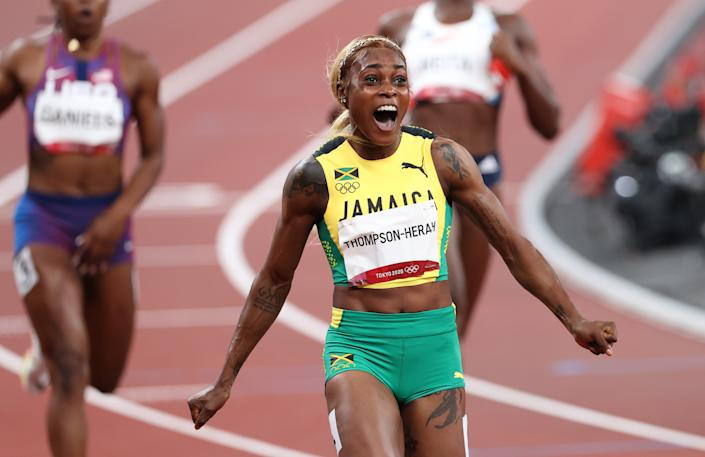 Elaine Thompson-Herah of Jamaica celebrates victory in the women's 100m final at the Tokyo 2020 Olympic Game on July 31. ( Ian MacNicol/Getty Images)