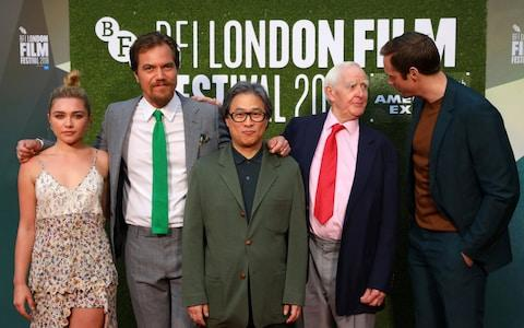 "Actors Michael Shannon, Florence Pugh and Alexander Skarsgard, together with director Park Chan-wook and author John le Carre, at the world premiere of ""The Little Drummer Girl"" - Credit: REUTERS/Simon Dawson"