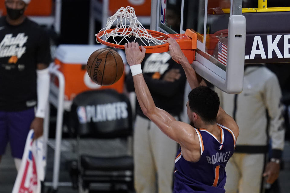 Phoenix Suns guard Devin Booker (1) dunks the ball during the fourth quarter of Game 6 of an NBA basketball first-round playoff series against the Los Angeles Lakers Thursday, June 3, 2021, in Los Angeles. (AP Photo/Ashley Landis)