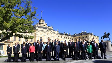 Leaders pose for a group photo at Constantine Palace in St. Petersburg