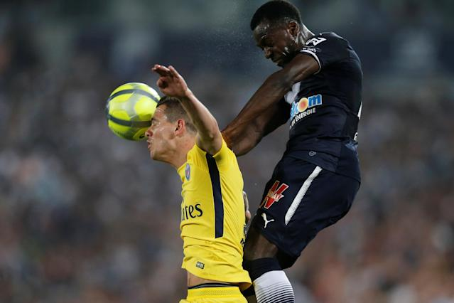 Soccer Football - Ligue 1 - Bordeaux v Paris St Germain - Matmut Atlantique, Bordeaux, France - April 22, 2018 Paris Saint-Germain's Giovani Lo Celso in action with Bordeaux's Maxime Poundje REUTERS/Regis Duvignau