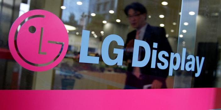 FILE PHOTO: A man walks out of the headquarters of LG Display in Seoul, October 20, 2011. REUTERS/Jo Yong-Hak/File Photo