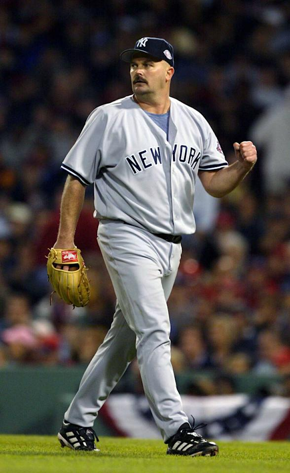 BOSTON - OCTOBER 14: Pitcher David Wells #33 of the New York Yankees pumps his fist during Game 5 of the 2003 American League Championship Series against the Boston Red Sox on October 14, 2003 at Fenway Park in Boston, Massachusetts. (Photo by Ezra Shaw/Getty Images)