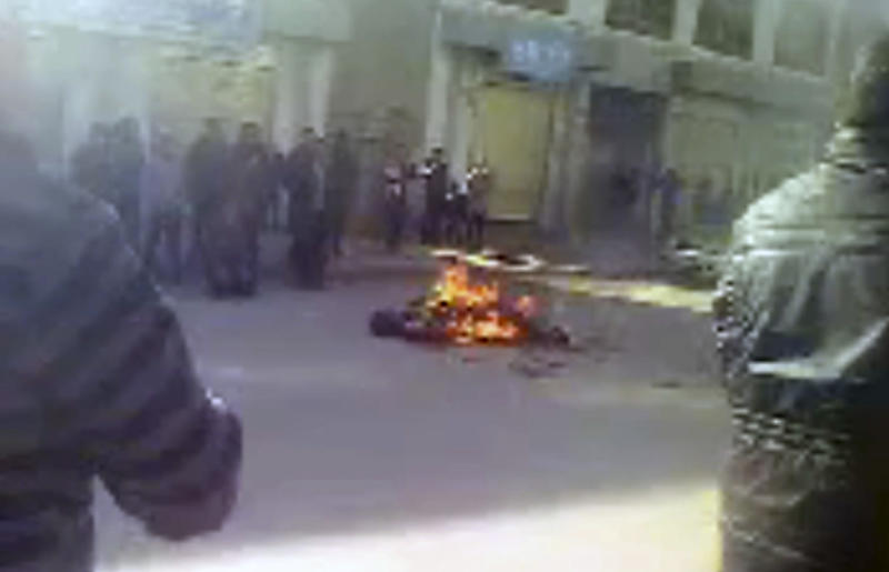FILE - EDS NOTE GRAPHIC CONTENT - This file image from video, released Friday, March 23, 2012 by London-based activist group Free Tibet, reportedly shows the self-immolation of Sonam Thargyal, a 44-year-old farmer who doused himself with kerosene before setting himself on fire earlier this month in Tongren, a monastery town in Qinghai province, western China. China has released a documentary accusing the Dalai Lama of orchestrating a wave of self-immolations by Tibetans, in its most elaborate attempt so far to shape international opinion about the protests against Chinese rule. (AP Photo/Free Tibet)
