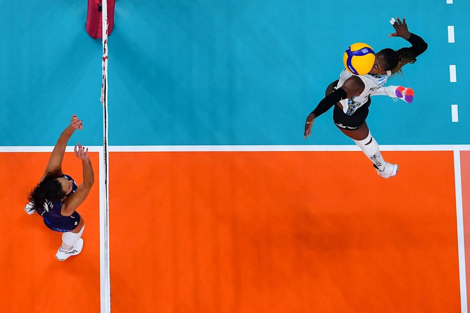<p>Argentina's Erika Mercado spikes the ball in the women's preliminary round pool B volleyball match between Italy and Argentina during the Tokyo 2020 Olympic Games at Ariake Arena in Tokyo on July 29, 2021. (Photo by Antonin THUILLIER / AFP)</p>