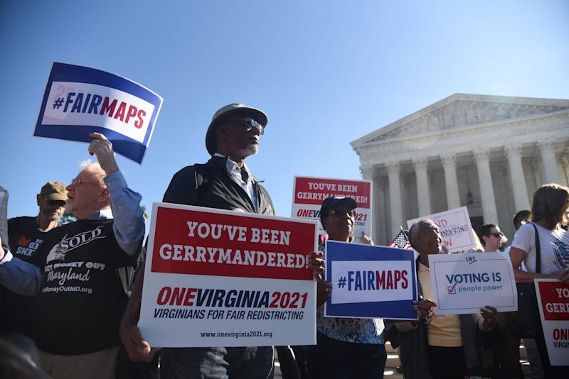 Demonstrators gather outside of the United States Supreme Court during oral arguments in Gill v. Whitford to call for an end to partisan gerrymandering.