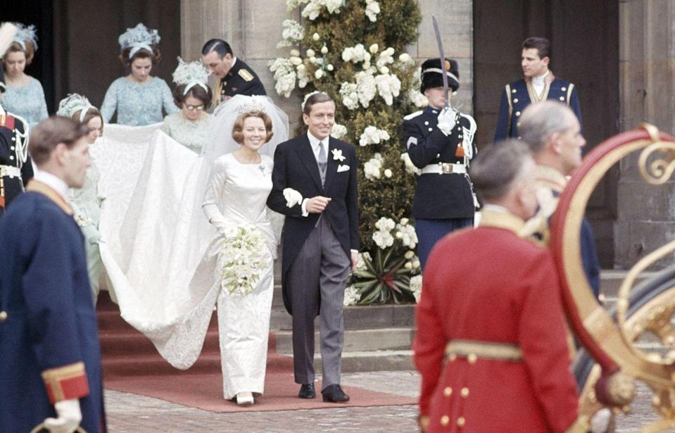 <p>The bride sported a slender, high neckline gown with a lengthy train made by Caroline Bergé-Farwick of Maison Linette, a couturier to the Dutch royal family. </p>