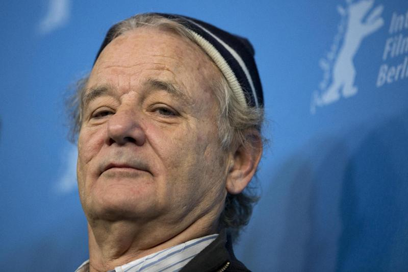 Actor Bill Murray poses for photographers at the photo call for the film The Grand Budapest Hotel during the International Film Festival Berlinale, in Berlin, Thursday, Feb. 6, 2014. (AP Photo/Axel Schmidt)