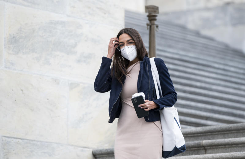 UNITED STATES - APRIL 23: Rep. Alexandria Ocasio-Cortez, D-N.Y., wears a face mask as she walks down the House steps of the U.S. Capitol before the House vote on the $483.4 billion economic relief package on Thursday, April 23, 2020.(Photo By Bill Clark/CQ-Roll Call, Inc via Getty Images)