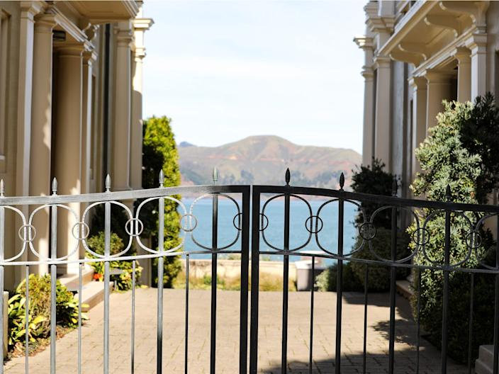 The ocean is in view beyond a pair of gates to a home on Sea Cliff Avenue.