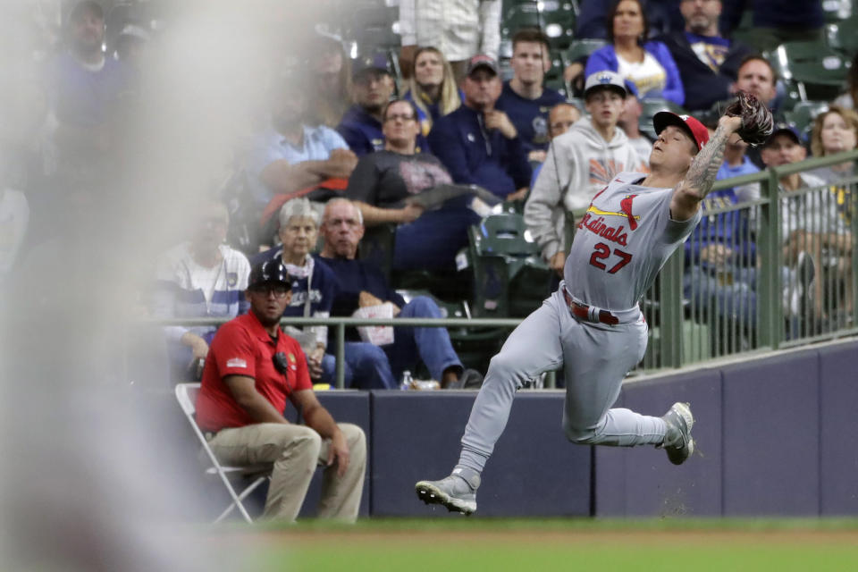St. Louis Cardinals' Tyler O'Neill makes a running catch during the fourth inning of a baseball game against the Milwaukee Brewers Tuesday, Sept. 21, 2021, in Milwaukee. (AP Photo/Aaron Gash)