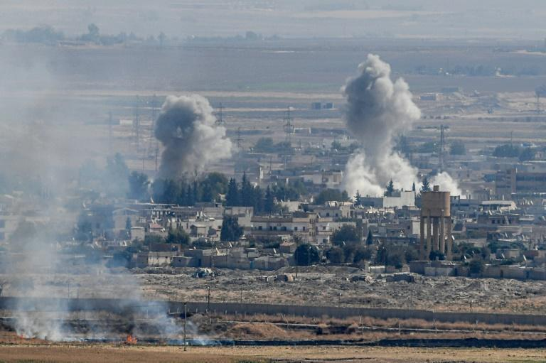 The ethnically divided Kurdish-held border town of Ras al-Ain is one of the key targets of Turkey's nearly week-old invasion and has ome under heavy bombardment (AFP Photo/Ozan KOSE)