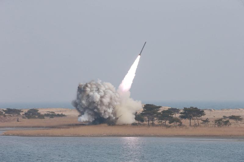 Undated photo released on March 4, 2016 shows a test-fire of a new large-caliber rocket at an undisclosed location in North Korea (AFP Photo/)