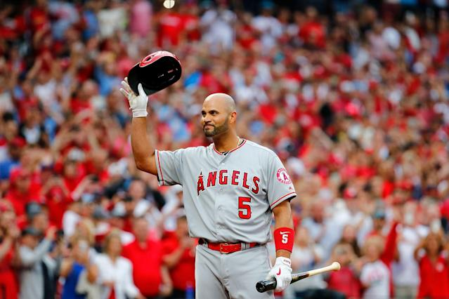 Albert Pujols was greeted with a one-minute standing ovation in his emotional return to St. Louis. (Photo by Dilip Vishwanat/Getty Images)