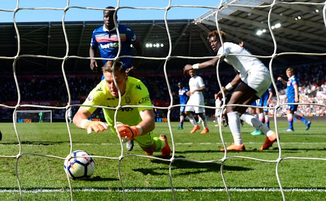 "Soccer Football - Premier League - Swansea City vs Stoke City - Liberty Stadium, Swansea, Britain - May 13, 2018 Stoke City's Jack Butland makes a save on the goal line REUTERS/Rebecca Naden EDITORIAL USE ONLY. No use with unauthorized audio, video, data, fixture lists, club/league logos or ""live"" services. Online in-match use limited to 75 images, no video emulation. No use in betting, games or single club/league/player publications. Please contact your account representative for further details. TPX IMAGES OF THE DAY"