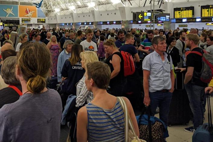 Big squeeze: the check-in area at Gran Canaria airport: James Lear