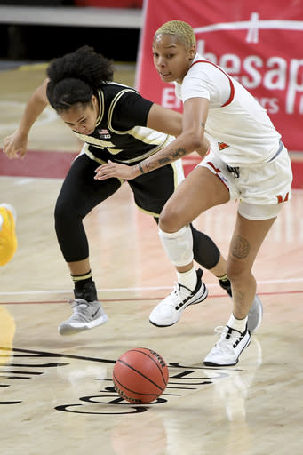 Purdue guard Jenelle Grant (22) and Maryland forward Alaysia Styles (5) go after a loose ball during the second half of an NCAA college basketball game, Sunday, Jan. 10, 2021, in College Park, Md. (AP Photo/Will Newton)