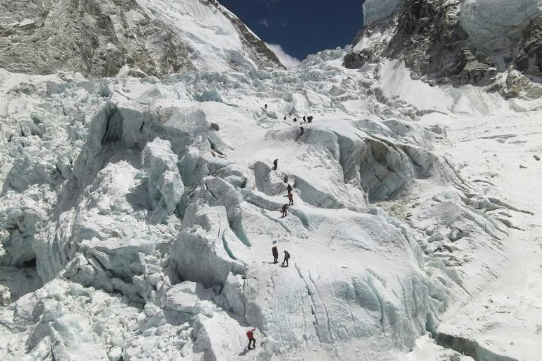 The warmer weather that usually ushers in safer conditions for scaling Himalayan peaks coincided with a deadly second wave of virus infections