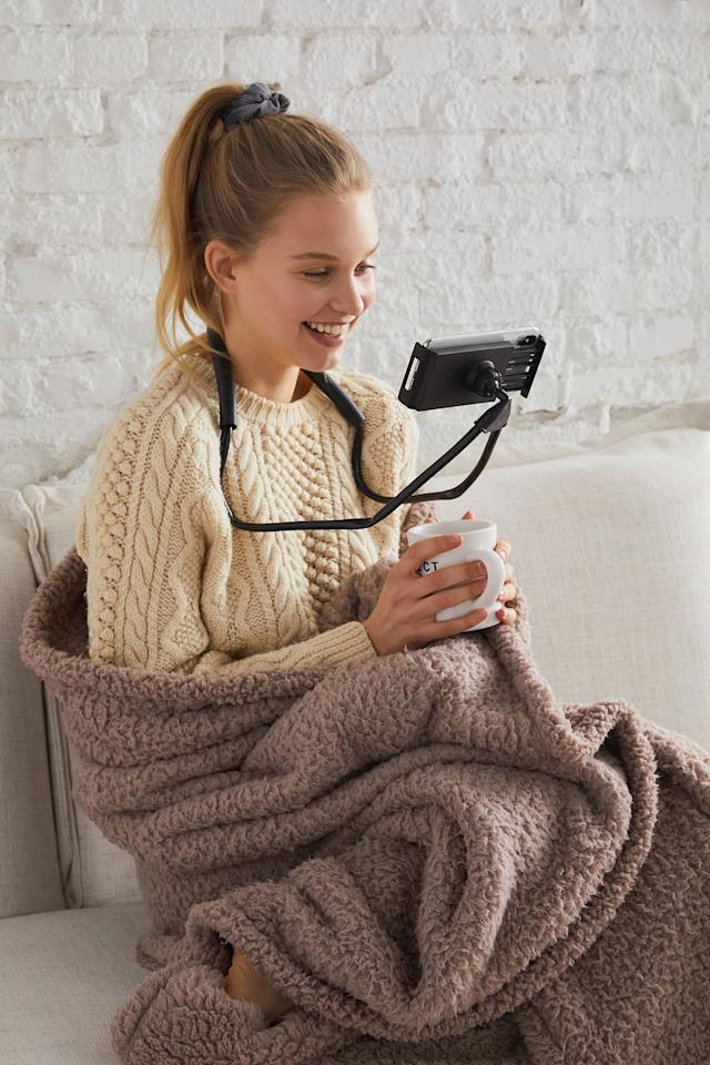 "<p>We all know someone who needs this <a href=""https://www.popsugar.com/buy/Adjustable-Neck-Smartphone-Mount-416222?p_name=Adjustable%20Neck%20Smartphone%20Mount&retailer=urbanoutfitters.com&pid=416222&price=12&evar1=geek%3Aus&evar9=44622392&evar98=https%3A%2F%2Fwww.popsugartech.com%2Fphoto-gallery%2F44622392%2Fimage%2F46745996%2FAdjustable-Neck-Smartphone-Mount&list1=shopping%2Curban%20outfitters%2Cgadgets%2Cgift%20guide%2Ctech%20shopping&prop13=mobile&pdata=1"" rel=""nofollow"" data-shoppable-link=""1"" target=""_blank"" class=""ga-track"" data-ga-category=""Related"" data-ga-label=""https://www.urbanoutfitters.com/shop/adjustable-neck-smartphone-mount?category=cell-phone-accessories&amp;color=001&amp;type=REGULAR"" data-ga-action=""In-Line Links"">Adjustable Neck Smartphone Mount</a> ($12).</p>"