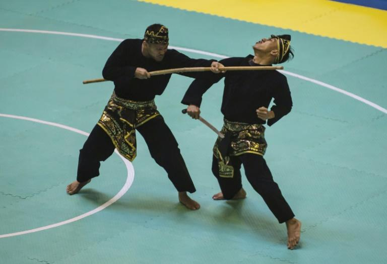 Legend has it that the ancient Indonesia martial art pencak silat originated after a woman watched a tiger do battle with a giant hawk